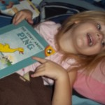 Ava in bed with The Story About Ping
